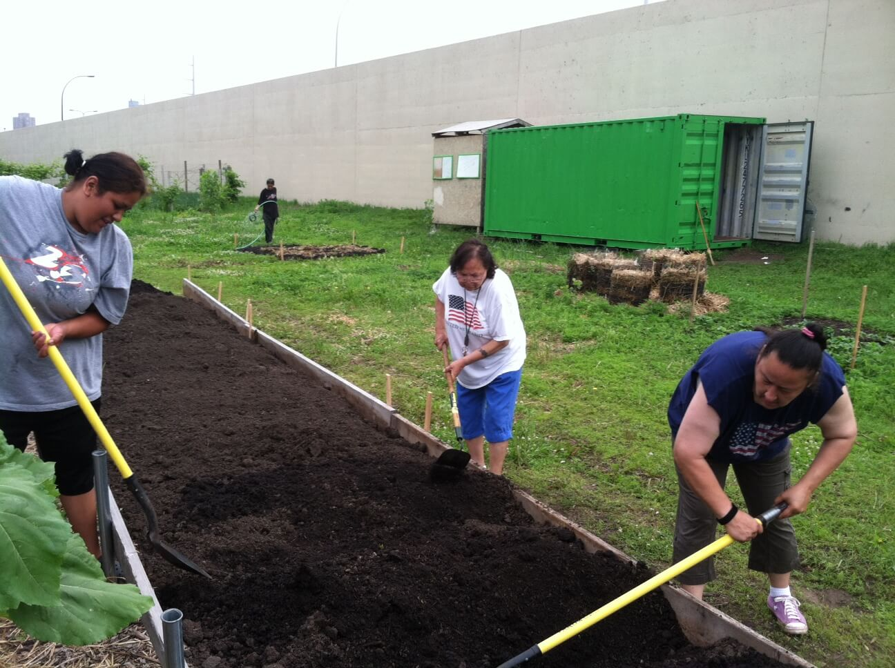 Little Earth urban farmers building raised beds